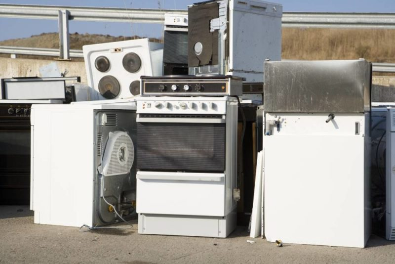piles of old appliances abandoned on road