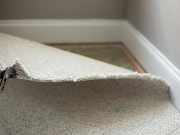 Old carpet during the carpet removal process